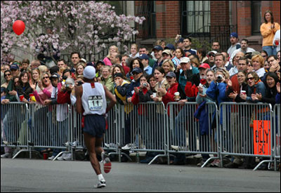 Meb Keflezighi, the top American finisher, hears it from the crowd on Commonwealth Avenue.