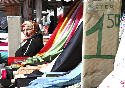 A woman sold fabric at a Turkish market in Berlin, a city redefined by immigration.