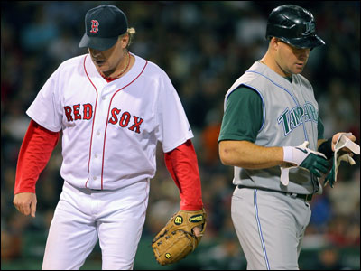 Curt Schilling (right), who improved to 4-0, left Ty Wigginton looking for answers at the end of the fourth inning.