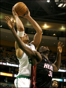 Dwayne Jones goes high over Earl Barron of the Heat for one of his 10 rebounds, and the Celtics, taking advantage of some missing Miami stars, posted an 85-78 victory.