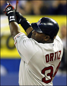 David Ortiz follows through after launching his first-inning home run in yesterday's win at Toronto. Big Papi's other hit, a bunt single to down the third-base line against the shift, was a hot postgame topic, however.