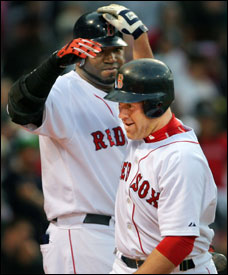 Kevin Youkilis (right) is content to leave most of the slugging on the team to David Ortiz.