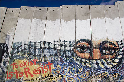 The concrete portion of Israel's West Bank security barrier has become an inviting canvas for artists from around the world who sympathize with the Palestinians. Above, a mural by a foreign artist near the Bethlehem checkpoint.