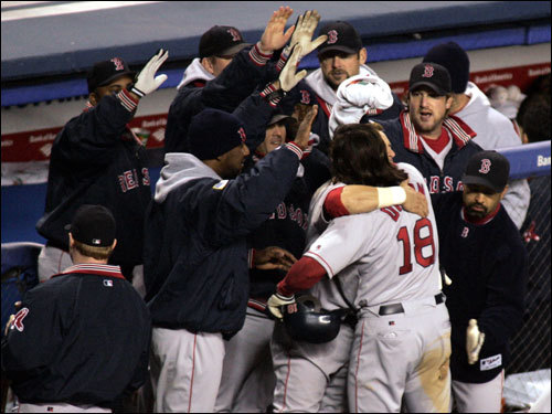 Oct. 20, 2004: Damon gets hugged after hitting his second home run of the night in the Bronx to send the Red Sox to the World Series.