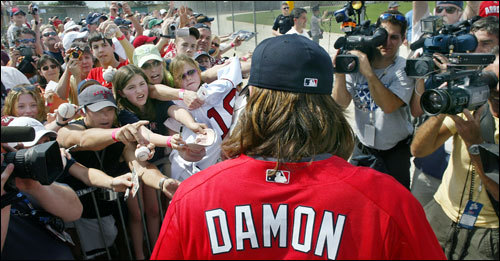 Feb. 22, 2005: The scene at the Red Sox minor league facility looked more like a rock concert than a sporting venue, and at no time did it more so than when Johnny Damon came out of the clubhouse and made his way to the field. With his hair flowing out of his hat, he was surrounded by screaming fans on his left, some young, some old, some male, some female.