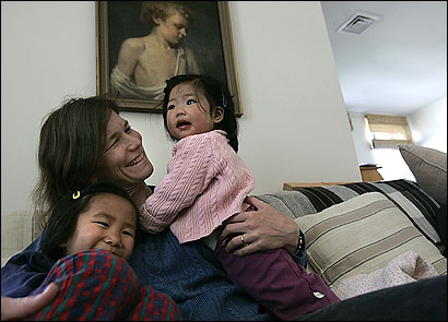 Andrea Geyling of Milton with daughters Maya, 5, and Kyra, 1. Both girls were adopted from China, which has set limits on the percentage of adoptees who can be placed with single parents.