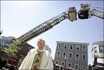 Two Boston tower trucks honored the Rev. Daniel J. Mahoney, fire chaplain, who marked 50 years as a priest yesterday.