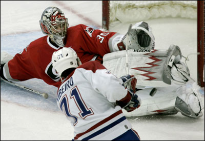 Hurricanes goalie Cam Ward sprawls to thwart a point-blank bid by Montreal's Mike Ribeiro in the third period.