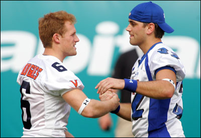 Memphis kicker Stephen Gostkowski (right) is congratulated by Virginia's Connor Hughes at an All-Star competition in January at Dolphins Stadium.