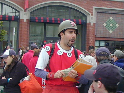 Program vendor Sly Egidio filled the air outside of Fenway Park with calls of 'Traitor Damon!'