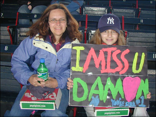 Michelle Alfond and her daughter Katie had different opinions of Damon. Michelle, a Red Sox fan, booed Damon. Katie, a Yankees fan, cheered for him and made him a sign.