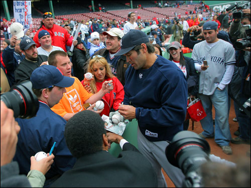 Johnny Damon signed autographs for Yankees and Red Sox fans alike prior to making his first start at Fenway Park for the New York Yankees.