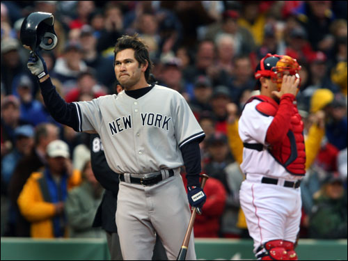 Johnny Damon tipped his helmet to the crowd before he led off the game for New York. Mirabelli, who had just arrived at the park, stood at right.