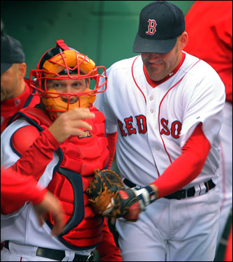 Kevin Youkilis welcomed returning catcher Doug Mirabelli, who arrived just before game time with a police escort.