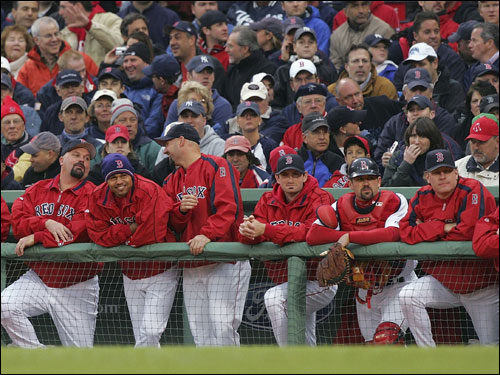 Members of the Boston Red Sox watched the first inning on the top step of the dugout.