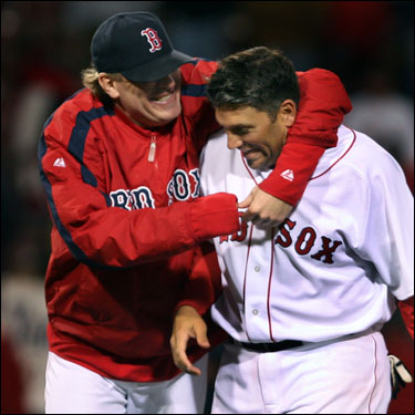 Curt Schilling gave Doug Mirabelli a hug after the Red Sox' 7-3 win over the Yankees.
