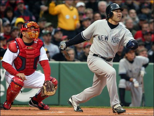 Johnny Damon and Doug Mirabelli watch Damon's fly ball in the first inning. Damon went 0 for 4 in the game.