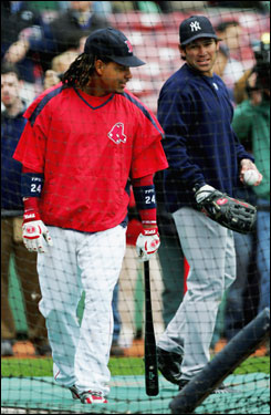 Manny Ramirez talked with former teammate Johnny Damon outside the cages during batting practice.