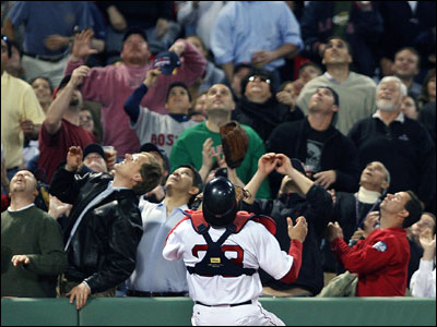 A great many people are looking to catch Blue Jay Lyle Overbay's fourth-inning popup, but it's Red Sox catcher Jason Varitek who makes the grab along the wall near the Boston dugout.