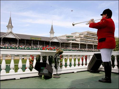 Bugler Steve Buttleman called the fifth race to post.