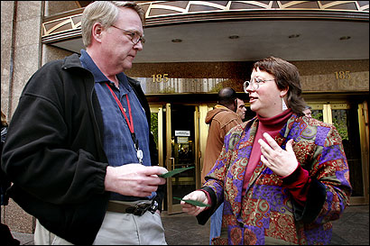 Green-Rainbow candidate Grace Ross spoke with Verizon employee Jim Beggan last week in Boston.