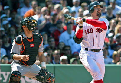 Red Sox catcher Jason Varitek (right) and Orioles' catcher Ramon Hernandez watch the flight of the Boston captain's grand slam in the bottom of the first inning.