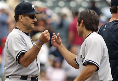 Yankees manager Joe Torre (left) is congratulated by center fielder Johnny Damon after New York closed out a victory over the Rangers. The win was Torre's 1,000th as the Yankees manager.