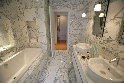 Philippe Starck's bathrooms feature marble from Tuscany.