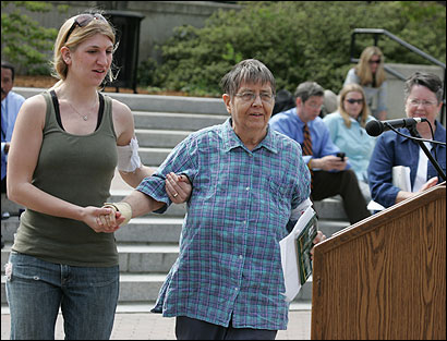 Sasha Westerman helped Mary Daly, a former Boston College professor, to the podium at a rally yesterday on the campus.