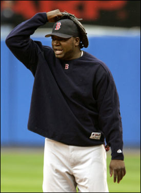 Red Sox DH David Ortiz protected himself from a drizzle during warm-ups at Yankee Stadium.