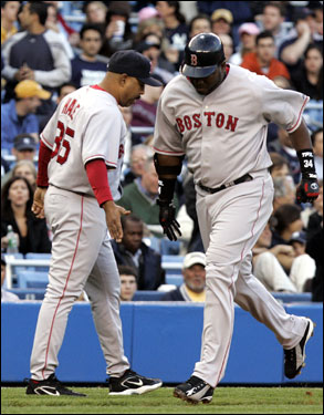 Ortiz was congratulated by third base coach DeMarlo Hale while rounding the bases.