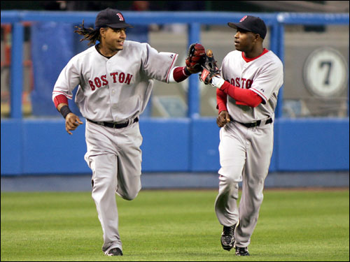 Manny Ramirez was congratulated by Red Sox center fielder Willie Harris after the inning ending catch.
