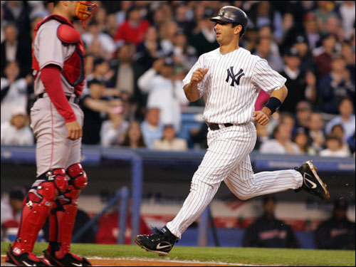 Jorge Posada jogged to the plate past Red Sox catcher Jason Varitek in the second inning. Posada scored on Bernie Williams' sacrifice fly.