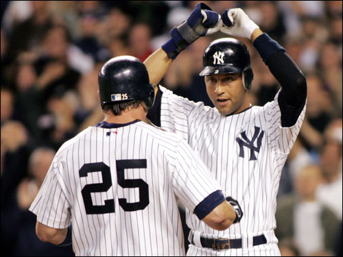 Derek Jeter and Jason Giambi celebrated the home run at the plate.