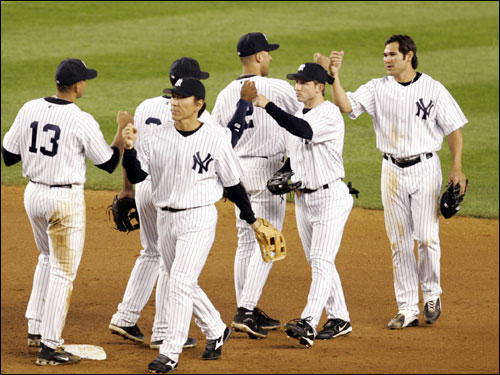 Former Red Sox outfielder Johnny Damon congratulated the rest of his Yankee teammates after the Yankees defeated the Red Sox at Yankee Stadium.