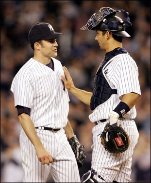Yankees catcher Jorge Posada had a meeting on the mound with Mike Mussina.