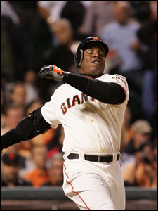 Barry Bonds has himself turned inside out after swinging and missing a Carlos Zambrano pitch in the fifth inning