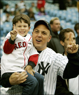 Eddie Mattera, of New York, and his four year-old son Nicholas, who root for opposite teams, were on hand for batting practice before the third game of the series.
