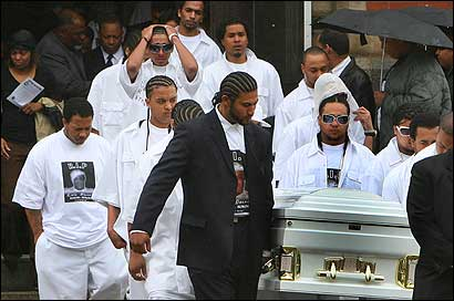 The casket of Luis DoSouto was carried from St. Patrick Church in Roxbury yesterday after a funeral for the 25-year-old Cape Verdean man slain Saturday.