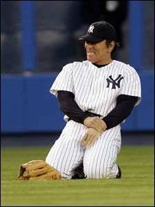 Yankees left fielder Hideki Matsui holds his wrist after breaking it while attempting to make a sliding catch in the first inning. He will have surgery today.