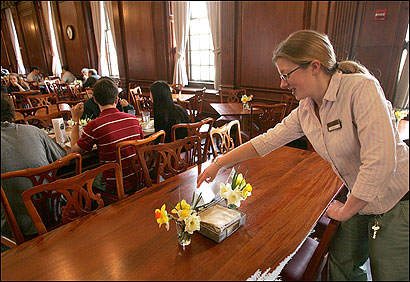 Aurora Nichols works at a residential hall at Yale University, making sure flowers have been placed in the dining areas.