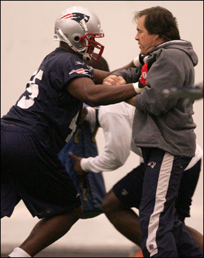 Belichick had his hands full as he works with linebacker Jeremy Mincey.