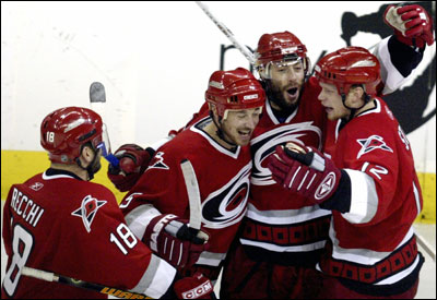 Mark Recchi, Frantisek Kaberle, Matt Cullen, and Eric Staal celebrate Kaberle's tying goal.