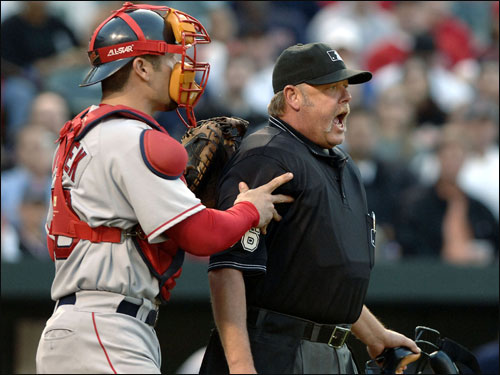 Red Sox catcher Jason Varitek held back home plate umpire Jim Joyce after he Josh Beckett had words about a time out called in the first inning at bat by Miguel Tejada.