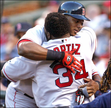 Wily Mo Pena got a hug from fellow Dominican slugger David Ortiz after his opposite field shot.