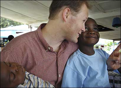 Ian Gee, a lawyer from Idaho, talked with his newly adopted son, Obdiyeah, 5, as Lincoln, 13 months, also just adopted by Gee, slept on his arm last week in Monrovia, Liberia. The number of adoptions from Liberia greatly expanded after 2003, after the end of 14 years of civil war.