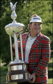 Tim Herron poses with the Leonard Trophy after winning the Colonial golf tournament.