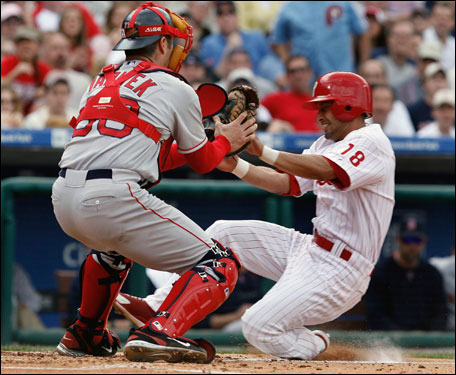 Red Sox catcher Jason Varitek applied the tag at home plate on the Philadelphia Phillies' Shane Victorino during the second inning.
