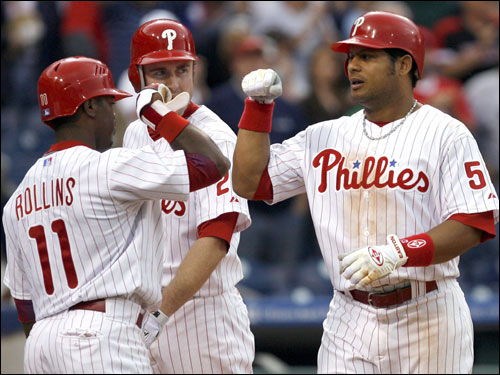 Bobby Abreu (right) celebrated his home run with teammates Jimmy Rollins (11) and Chase Utley.