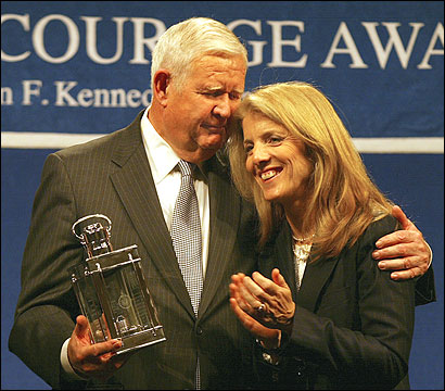 Representative John P. Murtha, a Pennsylvania Democrat, received a Profile in Courage Award from Caroline Kennedy yesterday at the John F. Kennedy Library and Museum in Boston. Alberto J. Mora, a former general counsel for the Navy, also received the award. The men had broken ranks with the Bush administration over its handling of the war.